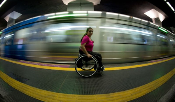 Brazilian Viviane Macedo, 35, looks on as a metro car arrives at a station in Rio de Janeiro on September 10, 2012. Macedo, who has won for 5 times the Brazilian championship of wheel chair dance, suffers as thousands of handicapped people in Rio de Janeiro, the city which will host the Paralympic Games in 2016. AFP PHOTO / Christophe Simon